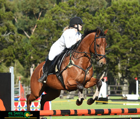 Tia Frost competes her 14 year old Thoroughbred gelding, Cadbury in the 1.10m at the Cabarita Beach Spring Show Jumping Classic.