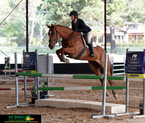 With Deborah Kelley in the saddle, Willow Connie leaves ample room to spare over the EvA105 show jumping fences at the NEGS One Day Event.