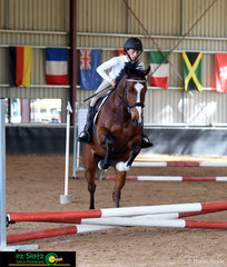Mr Chubby Choo clears each fence in the EvA45 with Marina Morel in the saddle at the NEGS One Day Event in Armidale.