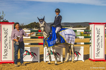 Olivia Hamood and Carado GHP presented with the 2018 Horseware Boneo Cup trophy by Boneo Park director Scott McNaught.
