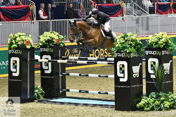 Last to go in the  $36,000 Brickenden International Jumper Class jump off, Irishman, Cpt. Brian Cournane outpaced the field to win riding the Irish Sport Horse, 'Penelope Cruz' by Ustinov.