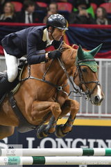 One of the Australian showjumping WEG heros, Rowan Willis, complete with green and gold ear bonnet, jumped two super rounds aboard his talented WEG mare, 'Blue Movie' by Chacco Blue, to take fourth place in the $85,000 'Big Ben' International Challenge on Thursday night.