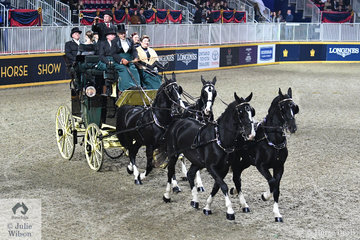 Dr Rae and Nancy Fischer's team of impressive Dutch Warmbloods pulling a Kimble Park Drag, with Dr Fischer at the reins won the Green Meadows Coaching Pleasure class on the final night of the 96th Royal Agricultural Winter Fair.