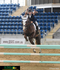 Tyler Short navigates Mauve Keeva Casteil around the 1m track at the Queensland Indoor Show Jumping Championships held at QSEC.