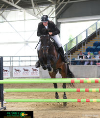Sebastian Fox steps into the main arena competing in the 1m and 1.10m classes at the Queensland State Show Jumping Championships on his 10 year old gelding, Louis Vuitton, bred by Andrew Inglis