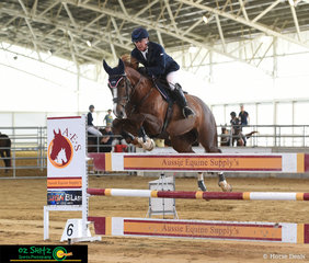 Final class of the weekend at the QSEC Indoor Arena was the 1.20m - Peter Carcary and Festa D clear the Aussie Equine Supplies fence in the first round of competition