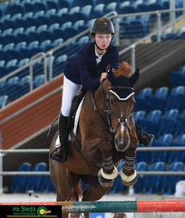 Paige Johnston and WP Cool As are a picture of concentration as they take on the triple bar in the 1.20m