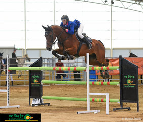 Yandina local, Courtney Tincknell takes the win in the Oz Shotz Photography sponsored 1.20m Championship Class on her horse Second Chance at the Queensland Indoor State Championship