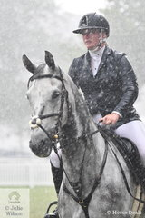 Isabella Dobson from WA is enjoying some Victorian Spring weather. The young rider is pictured making the most of the bad weather during the  Australian Quality Pet Foods Future Stars  class riding her, 'Tulara Corango'.