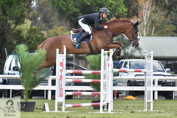 Leon Carroll divides his time between commentating and riding. He does both well. Leon is pictured aboard his, 'Mia Catalina' that posted a double clear in difficult conditions to take fifth place in the  Australian Quality Pet Foods Future Stars  class.