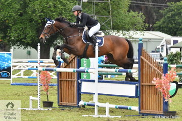 Hard working volunteer, Sophia Carlon rode her, 'Revevator' to take third place in the ISJ Interschool Showjumping Junior Championships.