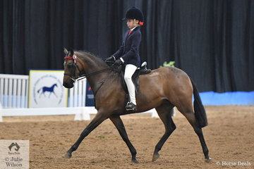 Following a family tradition and riding for Queensland, Mackenzie Thompson rode Alexia Fraser's, 'Beckworth Charming Dream' to take  third place in the Child's Medium Pony Championship.