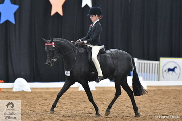 A busy Elizabeth Taylor rode  Renee Dorney's, 'Nottingham Love Song' to claim the Child's Large Pony Championship for NSW.