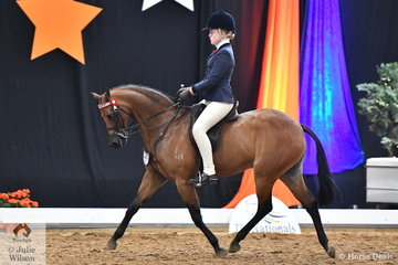 Representing Queensland, Ada Spring rode, 'Bamborough Mickey J' to take third place in the Child's Large Pony Championship.