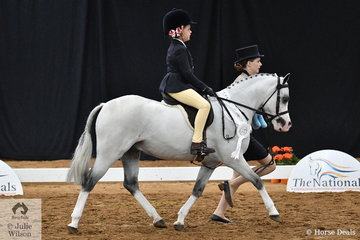 Representing NSW, Ruby McAuliffe rode Julie Tonkin's charming and good moving, 'Arcadian Enforcer' to claim third place in the National Leading Rein Show Hunter Pony Championship with a little help from Briana McAuliffe on the end of the lead.