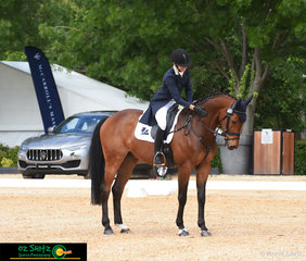 Michelle Robson gives Eastern Star Capone a well deserved pat at the end of their CCI Two Star dressage test at the 2018 Wallaby Hill Three Day Event.