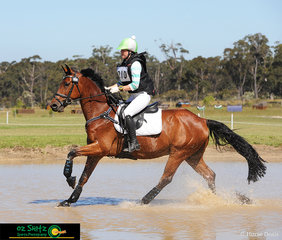 Making a splash through the water complex at the Wallaby Hill International Three Day Event was competitor Lily Wickenden on EA Berlin in the EvA95 class.