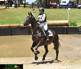Galloping out of the CCI Two Star water and eyes locked onto the next fence was Natalie Blundell and she rides her 11 year old gelding Summer Rhythm at the International Three Day Event held at Wallaby Hill Farm.