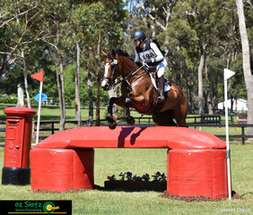 Rachael Lee and Holsteiner Lansina waste no time to talk on the phone so they make time out on the CCI Three Star cross country course at the Wallaby Hill Three Day Event..