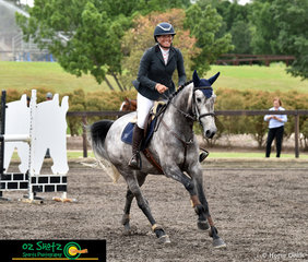 Happy with her round in the 4 year old class on Thursday, Jennifer Wood and Springshot B jumped a double clear round at the Summer Show Jumping Classic.