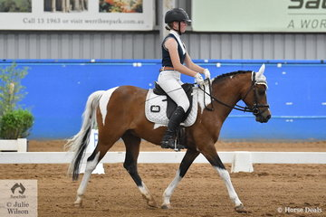 Meg Small rode her colourful, Balwarra Scorcher in the Preliminary 1.3.