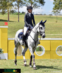 Queensland based rider, Maleah Lang-McMahon trots into the Super Junior Series Qualifier arena aboard her first horse on the draw, Vakarra Champagne the Summer Show Jumping Classic.