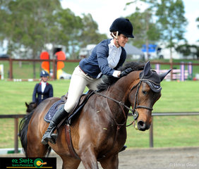 Happy with her clear round in the open 90-1.00m, Western Australian based rider Georgie Siciliano praises her horse Soverign's Boggabilla at the Sydney Summer Show Jumping Classic.