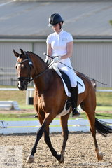 Emmalee Weston riding Hollands Bend Danseur took second place in the 4 year old test with 75%.
