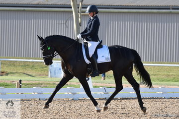 Justine Greer rode the stallion Revelwood Stedfast by Stedinger, to third place in the 4 yo class with a score of 73.8%.