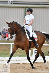 Fiona Selby took the weekend off from running Boneo Park to win the FEI Grand Prix riding, Tacita with a score of 67.5%.
