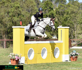 Jumping their way around the Amatuer track on day four of the Sydney Summer Show Jumping Classic was Abby West and Copabella Vermont.