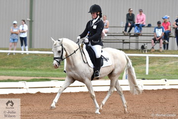 Emily Yeomann rode Cambridge Park Charli Brown to second place in the 5 YO pony class.