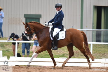 Jamie Page riding the good moving Fairbanks Revenge placed fifth in the 5 yo Young Horse class.