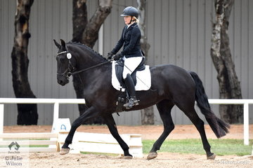 Stacey Willis riding the Friesian, Snow White of Ebony Park placed 5th in the Participation Preliminary 1.1.