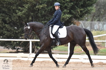 Janelle Young and Vivienne's Secret look to be having a nice time while riding their Participation Preliminary 1.2 test.