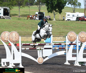And that is the money shot of Chris Chugg and Cera Carlina as they make easy work over the triple combination during the Mini Prix Series Final at the Sydney Summer Show Jumping Classic.