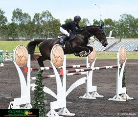 Queensland based rider Olivia Hamood and her European imported warmblood gelding, Alan III Z made the last element of the triple combination look small when they jumped over the wings in the Mini Priix Final on Sunday morning at the Sydney Summer Show Jumping Classic.