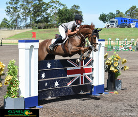 Tom McDermott and Yalambis Cassini Rosso make thier way around the Futurity Series Final course designed by International Course Builder, Leopoldo Palacios at the Sydney Summer Show Jumping Classic.