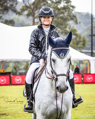 Maleah Lang-McMahon and 'Vakarra Champagne' win the class  in a time of 66.24 sec