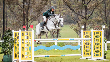 Chris Chugg and 'Cera Carlina' place fifth taking a rail in the jump off