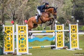 Tom McDermott and 'Alpha Activity are second, double clear in a time of 34.070 sec for Round 2 of the Grand Prix