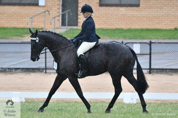Karissa Anderson is pictured during the First Season Hack Championship with her, 'Fantastic Porscha' (over 16.2hh)