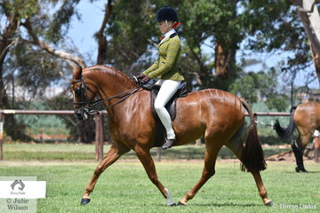 Izabella McIntyre rode Blaine Perkin's well performed, 'Mirinda Fortitude' to claim the Riding Pony Show Hunter Pony Championship.