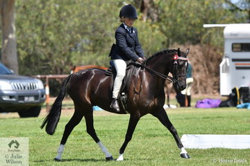 Gracie Humphries rode , 'Lonely Oak Hanky Panky' to win the Riding Pony Society class for Amateur Produced Show Pony N/E 14.2hh.