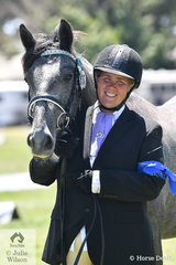 A delighted Jamila Davis is pictured with her two year old, Clydesdale/Warmblood/Percheron, 'Harley Davidson'  after winning the class for Lady Handler Youngstock in the Clydsdale Cross Sport Horse Association ring.