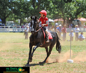 Oliver looks after his little jockey, Joshua Burke as they navigate their way through the 7 and Under 9 years bending race finals at the 2019 Kingstown Jamboree.