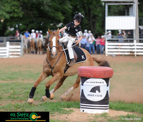 9 year old Harry Kelly from Yarrowyck, riding the 19 year old Stock Horse x Quarter Horse by the name of Cody, in the Barrel Race during the 2019 Kingstown Jamboree.