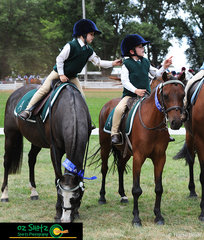 Winners of the Under 7 Pairs, Amelia Chick-Sauer riding Toby and Henry Rice riding Mighty Mouse, celebrate with a playful tug on one anothers helmet at the 2019 Kingstown Jamboree.