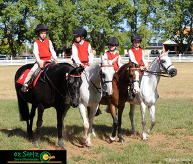 Joshua Bourke riding Oliver, William Schaefer riding Minty, Abbie Kelly riding Sir Leopold and Mackenzie Ellem riding Violet, take out first place in the Team of Four Sub-Junior class at the 2019 Kingstown Jamboree.