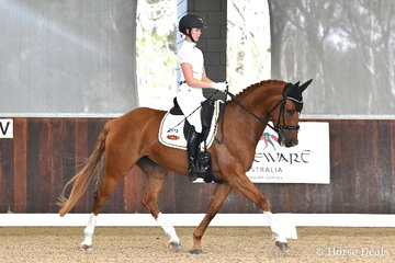 Jorjia Beard-Adams rode 'Carlyle Red Diamond' to score 73.40% for ninth place in round one of the Four Year Old Young Dressage Horse class.